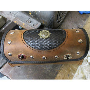 "Tool bag 10""x3.5""x5"". Custom brown leather, black basketweave, western scroll concho, spots -- $125"